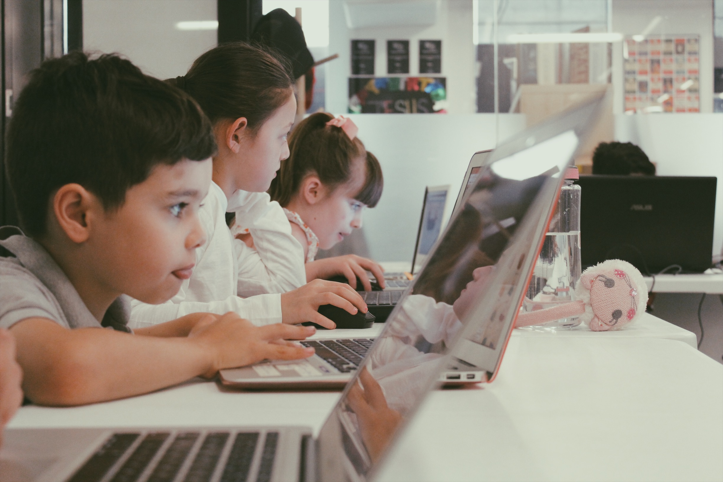 Lemonade Camp: kids work intently on their laptops