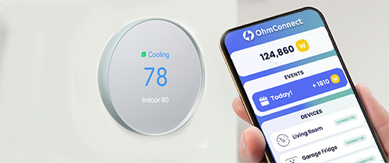 thermostat on the wall and a phone held in a hand showing how to earn rewards with smart thermostats