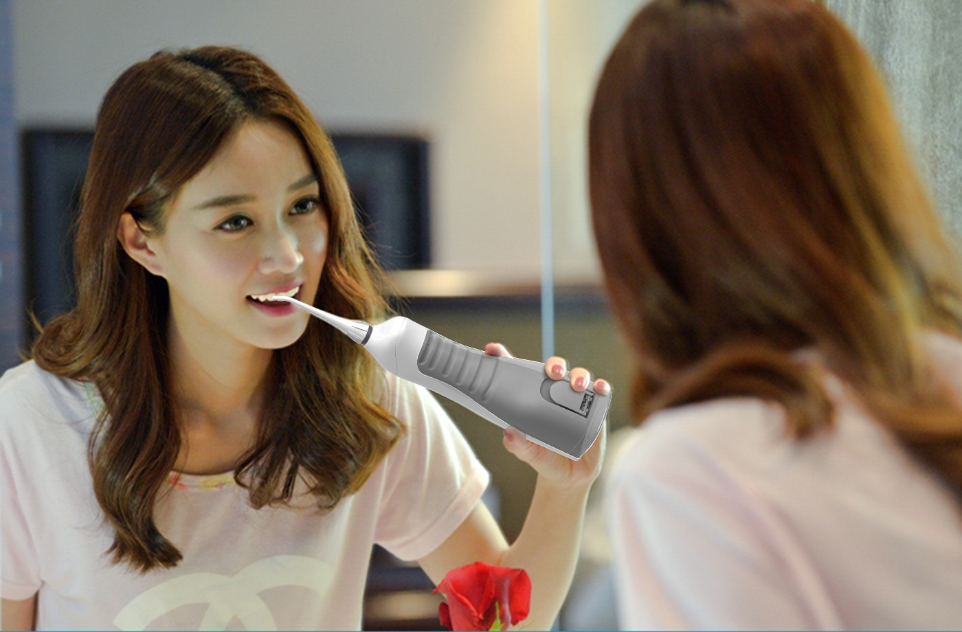 Woman using an oral irrigator