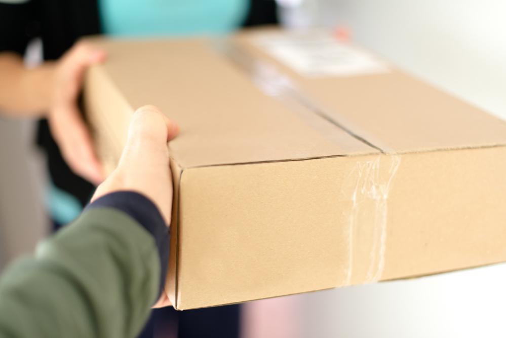 Handing over a parcel