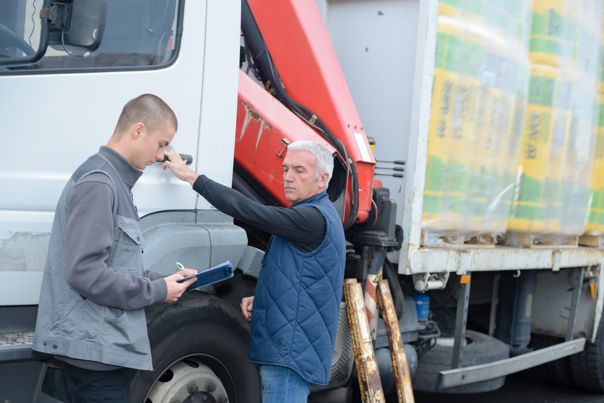 Driver getting his rig inspected