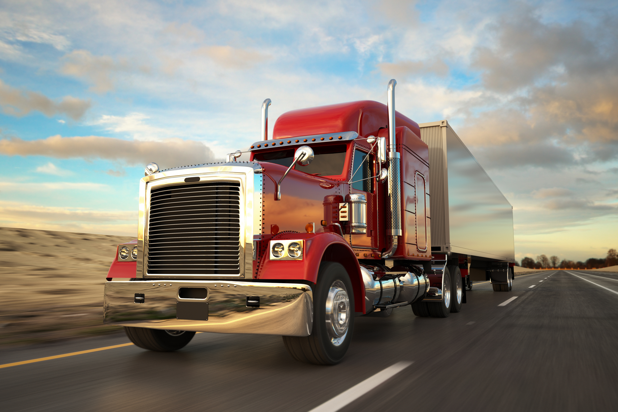 A red long haul truck on the road