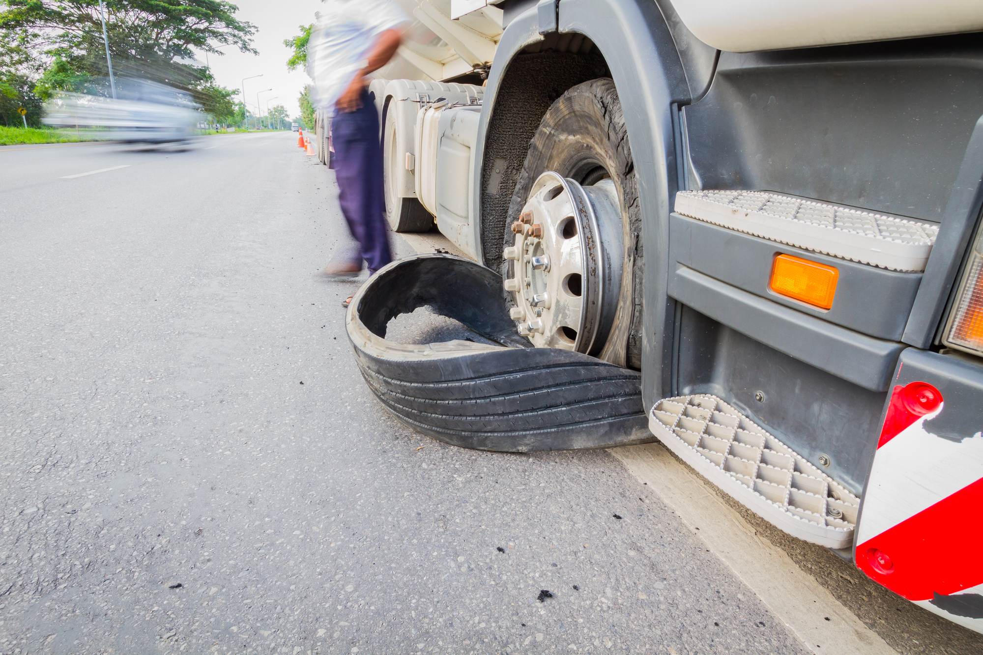 Semi truck with a flat tire