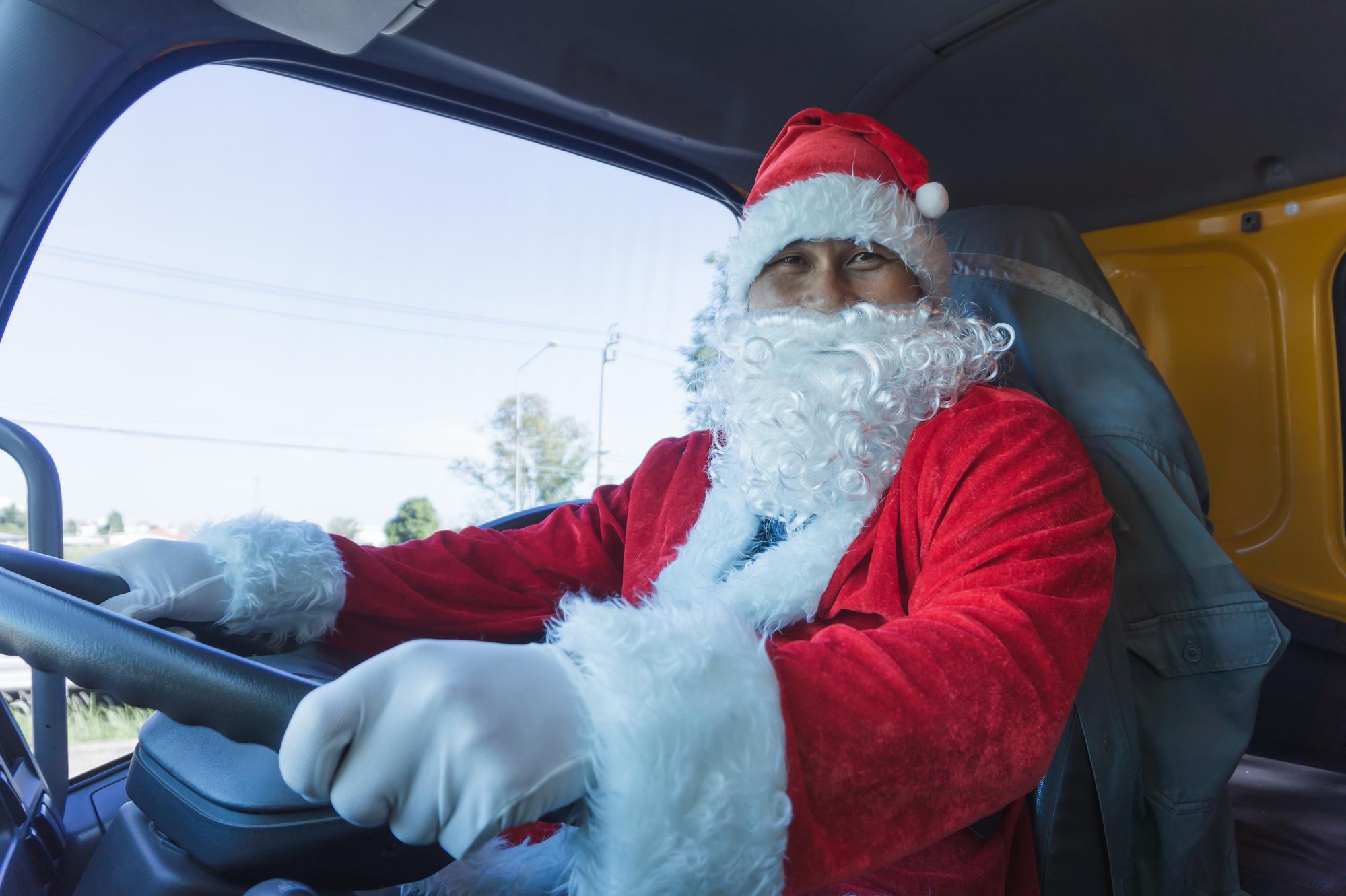 Santa Claus driving a truck