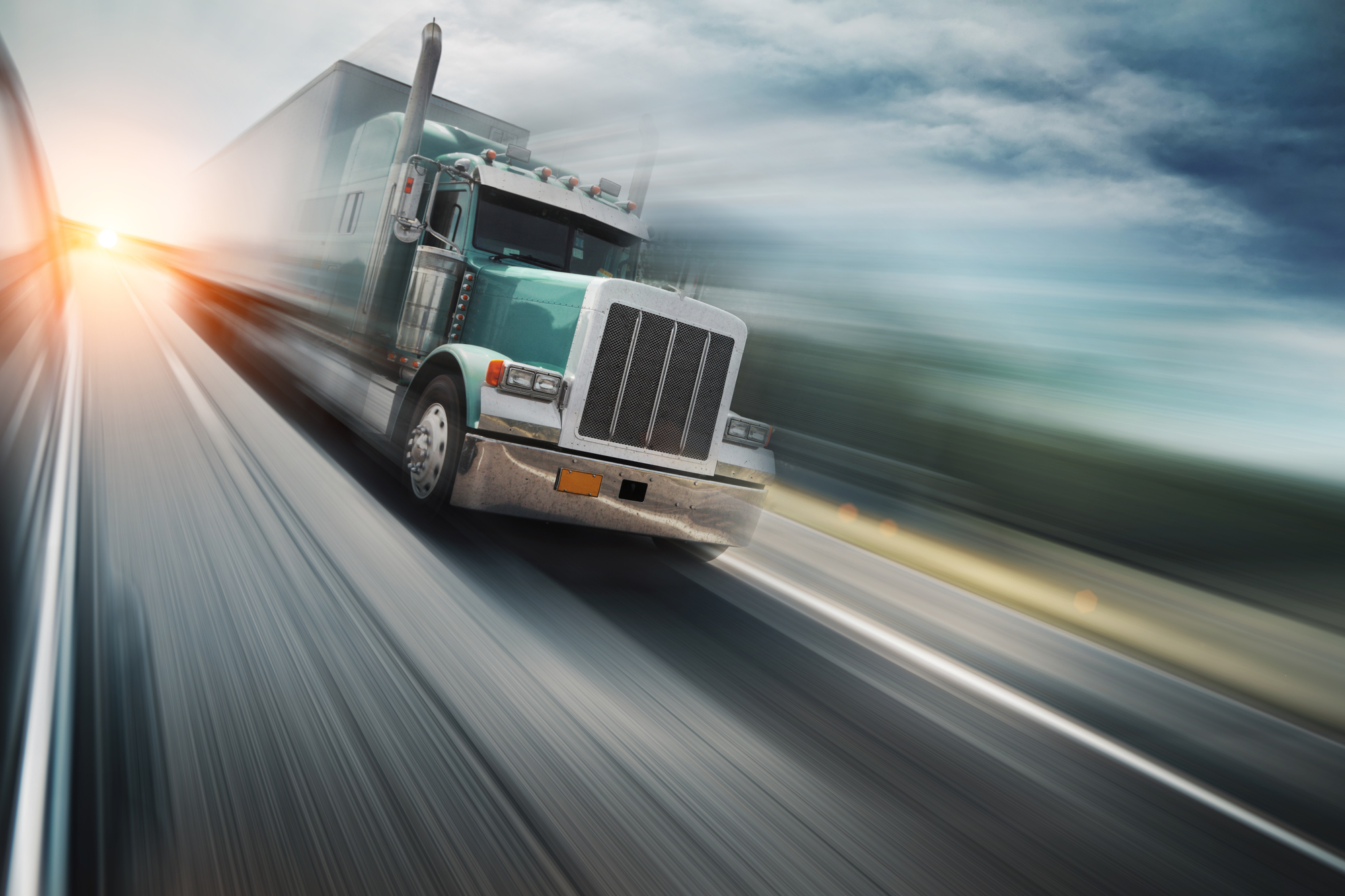 A truck driving fast on the highway