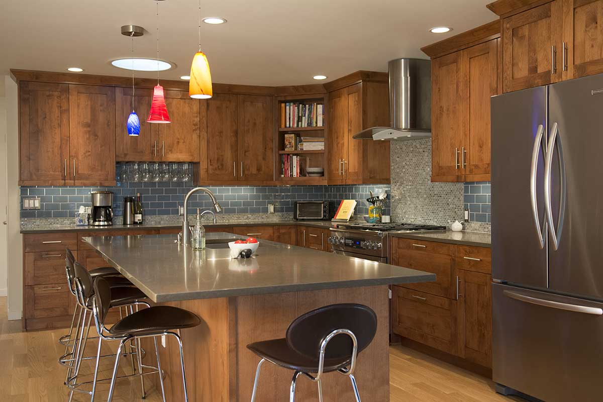 The Knotty Alder Cabinets And Bright Island Pendant Lights Let You Know You  Can Relax. The Quartz Countertops, Modern Stools And Appliances Communicate  That ...