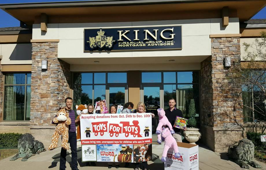 The King Team with their Toys for Tots donations.