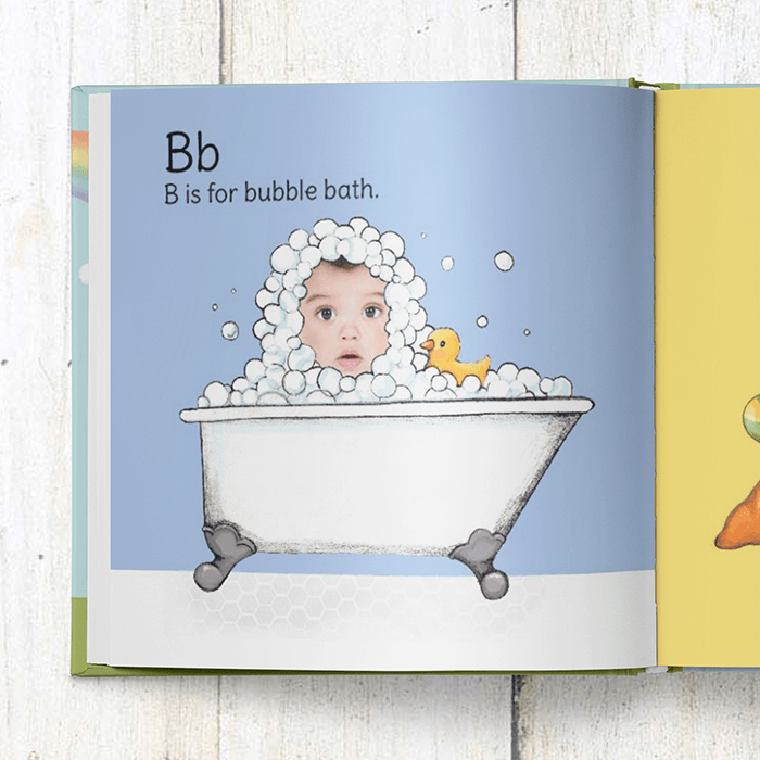 B is for bubble bath page of the personalized ABC book.  A photograph of the child's face is inserted into the illustration of a child's head that is covered with bubbles and peaking out of the top of a bathtub