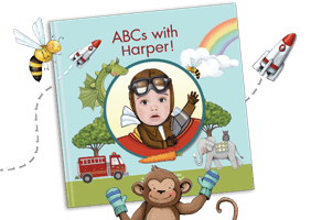 "Personalized children's book cover of ""ABCs with Me!"". Cover features a child dressed as a pilot wearing a pilot cap and goggles. Surrounding the child are various items such as a rocket ship, rainbow, firetruck, elephant. Cover is illustrated with the exception of the child's face which is an actual photo."