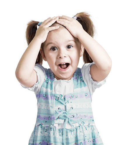 Happy and surprised looking girl with her head on her hands and mouth wide open, against a blue background with gift boxes and birthday candles