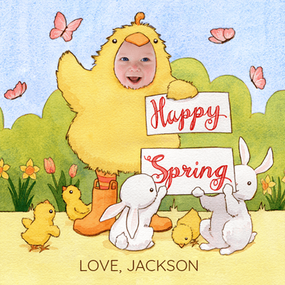 "A personalized Spring e-card, featuring a child named Jackson dressed as a yellow chicken holding a sign that reads ""Happy Spring"".  Small bunnies and chicks are at his feet with pink butterflies in the background. The card is illustrated except for Jackson's face which is an actual, cropped photo of his face"