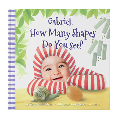 Personalized book for babies and toddlers: book cover of How Many Shapes Do You See? featuring a child dressed in a red & white striped hoodie, with a snail and egg in front and wind chimes and foliage in the background. Cover is illustrated with the exception of child's face which is an actual photo.