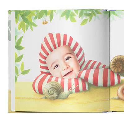 Sample book page showing a closeup of child in a red and white striped hoodie and leaning on a table with some snails crawling nearby.