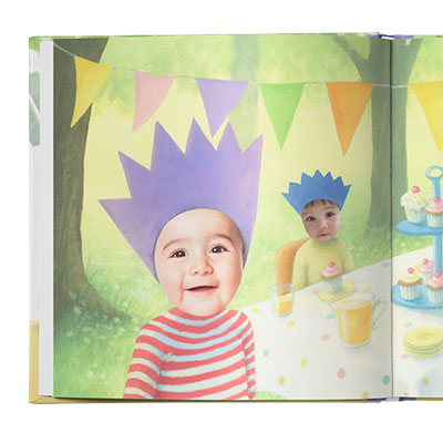 Image of two children with triangle bunting overhead, sitting at a table filled with cakes and drinks. Images of children are actual photos while the rest of the page is illustrated.