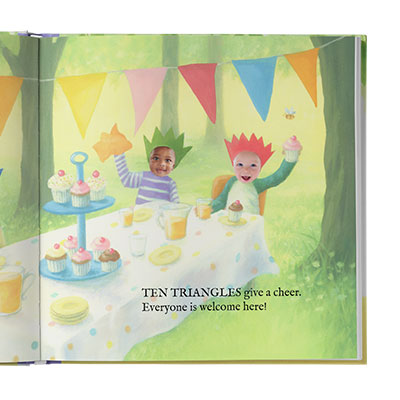 Image of two children with crowns on their heads, and triangle bunting overhead, sitting at a table filled with cupcakes, drinks, plates and cups. One child is waving a napkin in one hand, the other child is holding a cup. Images of children are actual photos while the rest of the page is illustrated.