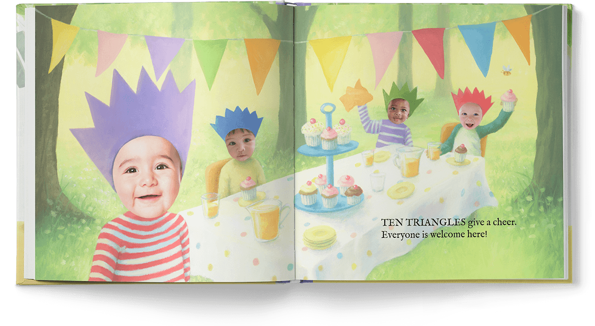 Open book spread of four children wearing crowns, sitting at a table with cupcakes and drinks with triangle shaped bunting overhead.