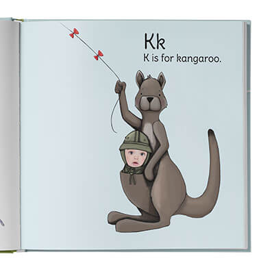 K is for kangaroo page of the personalized ABC book features an illustration of a kangaroo with the child in the pouch.
