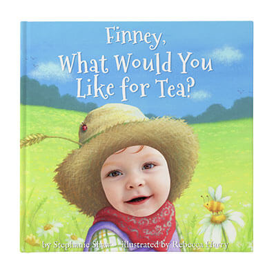 Personalized book for babies and toddlers: cover of What Would You Like for Tea? featuring a boy named Finney wearing a straw hat and bandanna around his neck against a meadow background