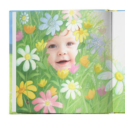 Illustration of colorful flowers and grasses with an actual photo of the child's face peeking through