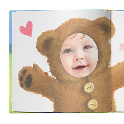 Sample book page of child dressed as a brown bear with arms outstretched. Page is illustrated with the exception of the child's face which uses an actual photo.
