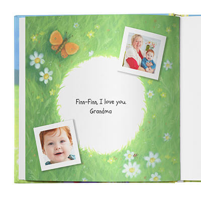 Dedication page with a grassy border dotted with small flowers. Personal message appears in the middle of the page and is flanked by two photos of the child and the child's grandmother.