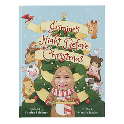 Personalized Christmas Book: book cover shot of Night Before Christmas, featuring a child dressed as a reindeer holding a plate of cookies, with a Christmas tree and animals in the background. Cover is illustrated with the exception of the child's face which is an actual photo.