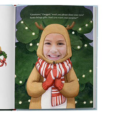 Closeup of main character dressed as a reindeer with a Christmas tree behind her. Page is illustrated with the exception of the child's face which is an actual photo.