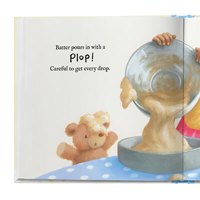 Sample book page showing a pair of child's hands pouring batter from a bowl into a cake pan.
