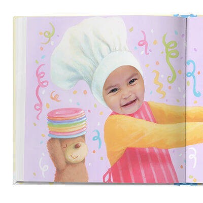 Sample book page with child and her teddy bear, and party decorations behind her. Image is illustrated with the exception of child's face, which is an actual photograph.