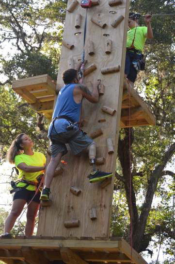 couple climbing a climbing wall