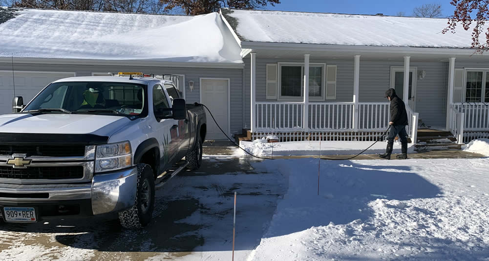 Safe winter driveways with liquid deicing service