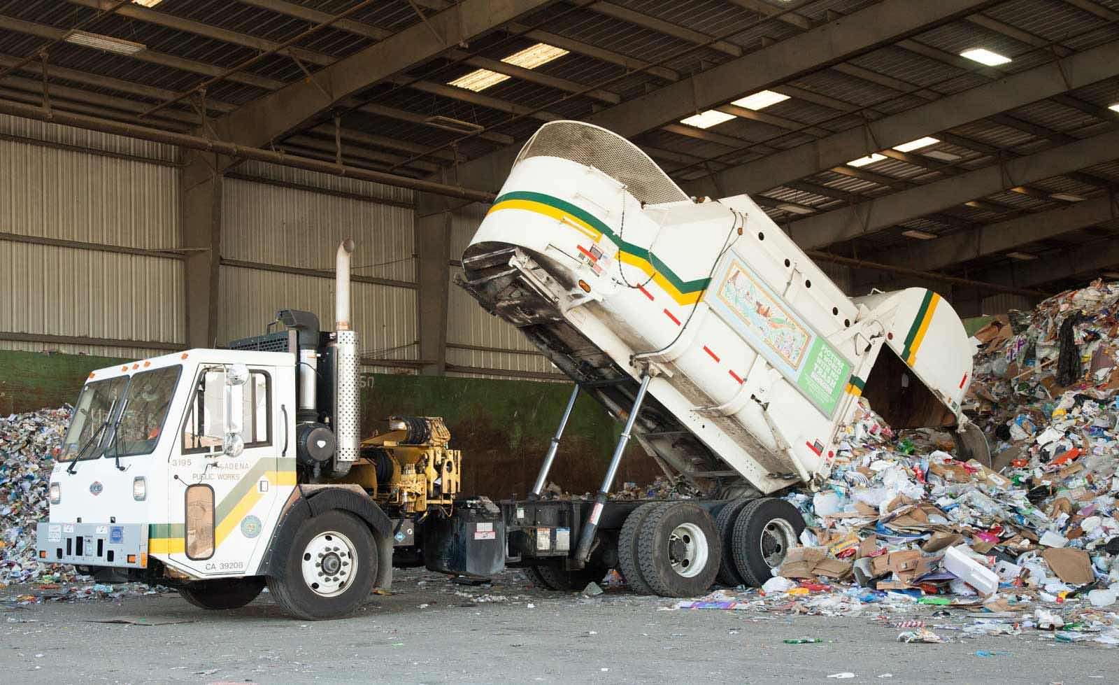 Allan Company Truck Emptying Recyclables