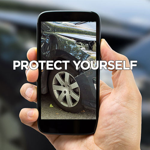 taking photo of car accident damage with cellphone