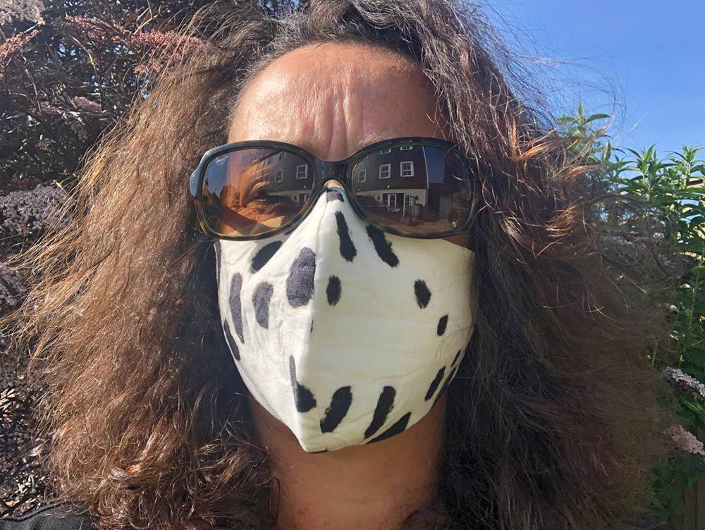 Ali wearing mask and shades