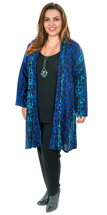 This model is wearing a colourful crepe kimono with button feature paired with Q'neel silky jersey vest and trousers in black available in plus sizes from Bakou in West Wimbledon