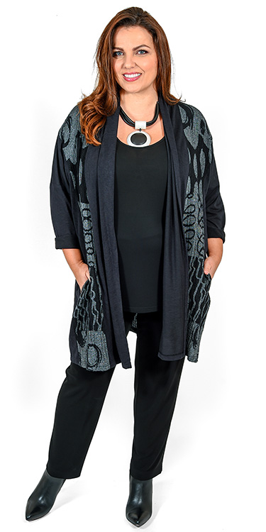 This model is wearing a stunning crinkle jersey grey and black circles print jacket by Q'neel teamed with Q'neel silky jersey vest and narrow trousers available in sizes 14-30 from Bakou in West Wimbledon