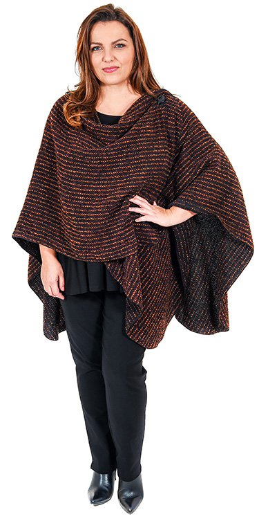 This model is wearing a gorgeous cape wrap in rust from Q'neel teamed with Q'neel panel t-shirt and Mona Lisa narrow stretch trousers