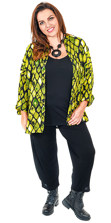 This model is wearing a gorgeous short oversized shirt from Masai in lime diamond print teamed with Q'neel short silky jersey vest and Masai Patti harem trousers