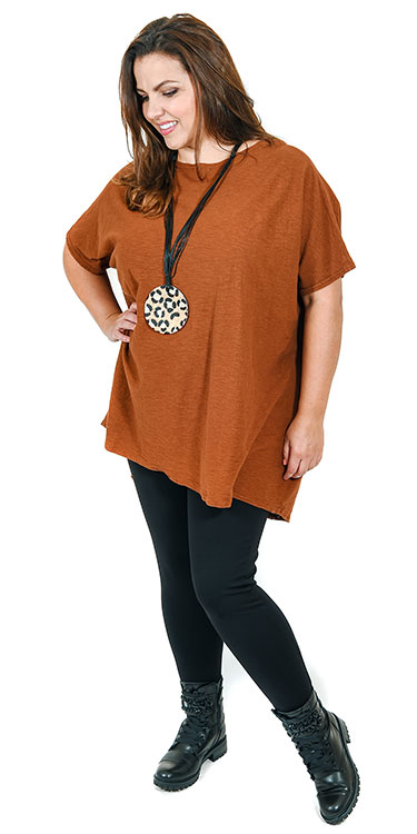 This model is wearing a fabulous one size cotton/line oversized tunic in rust from Cut Loose teamed with Kasbah leggings in black