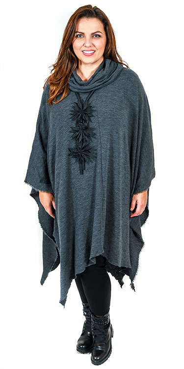 This model is wearing a luxurious long poncho from Basics teamed with Q'neel panel t-shirt and Kasbah leggings