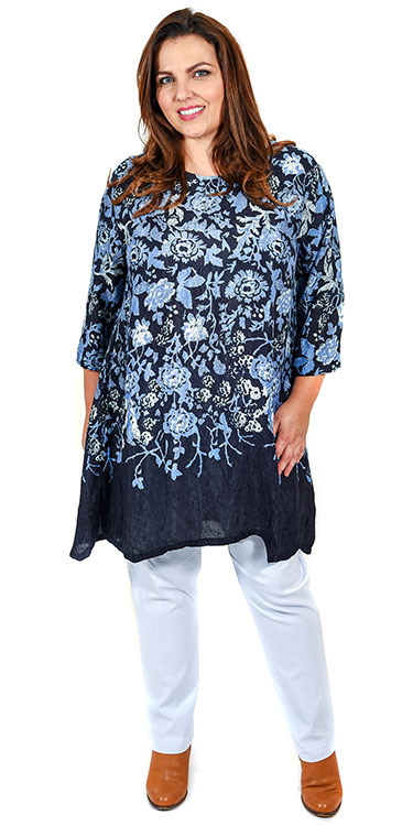 This model is wearing a striking floral tunic from Masai teamed with Mona Lisa narrow stretch white trousers