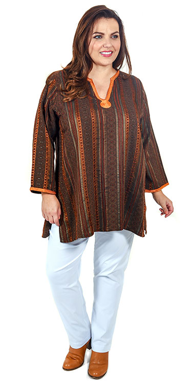 This model is wearing a gorgeous rust coloured ethnic Moroccan inspired v neck tunic paired with Mona Lisa white stretch trousers