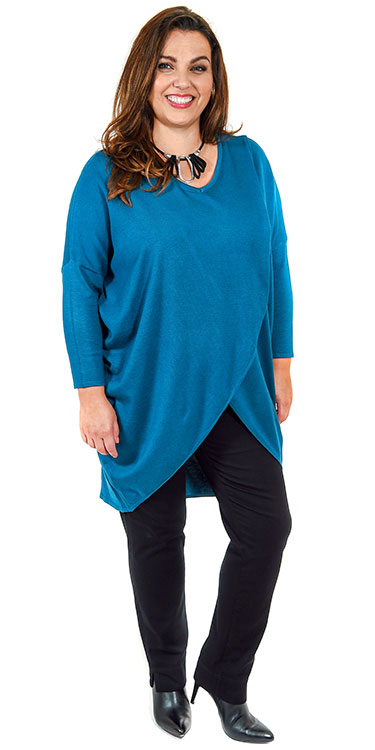 This model is wearing a striking cross over split jumper by Pont Neuf teamed with Robell pull on black jeans