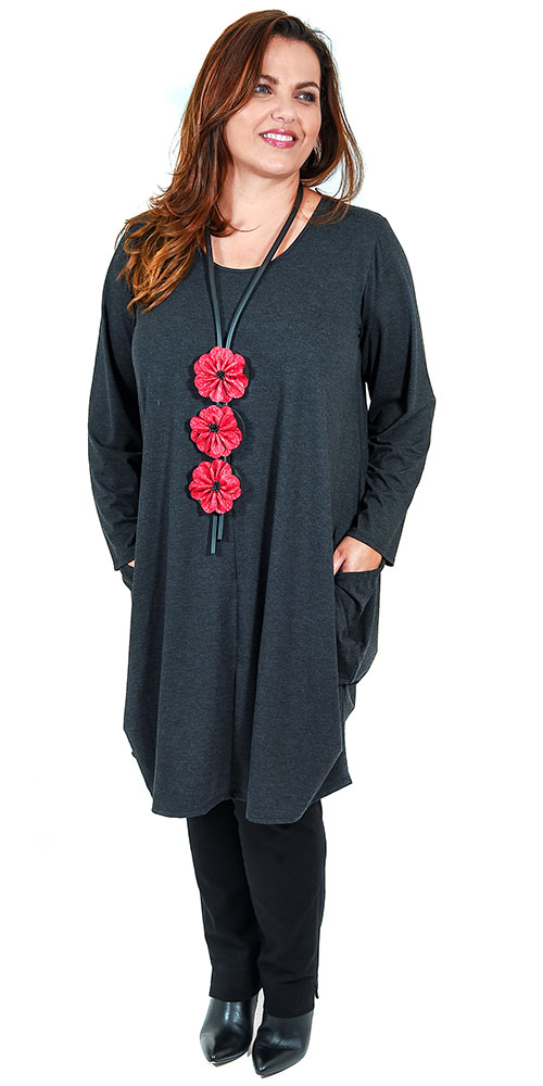 This image shows a soft jersey dress from Angel Circle with pull tie bottom feature in charcoal black, teamed with Robell pull on stretch jeans in black