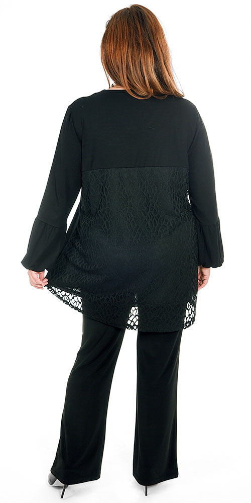 This image shows a model wearing a gorgeous puff sleeve top from See You which has a stunning lace feature on the back teamed with Yoek silky jersey bootleg trousers in black. Sizes 14-30