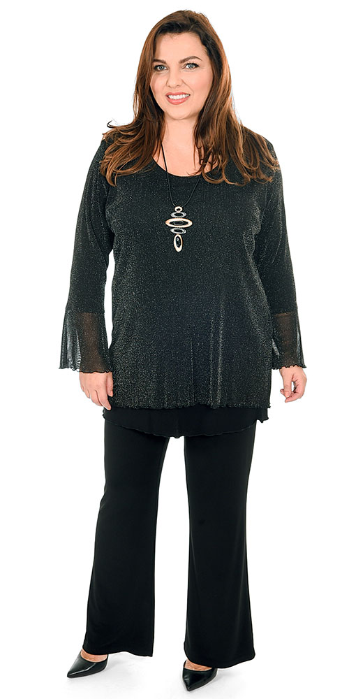 This image a model wearing a festive gold sparkly top with frill sleeves with Yoek silky jersey bootleg trousers in black. Plus sizes from Bakou in West Wimbledon.