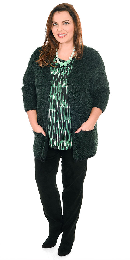 This image shows a model wearing a gorgeously soft furry cardi in forest green from K J Brand over a K J Brand brushstroke top and Robell faux suede narrow trousers