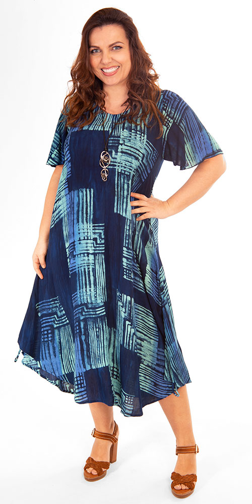 This image shows a model wearing an elegant short sleeved dress by Angel Circle. Available in sizes 14-30 from Bakou.