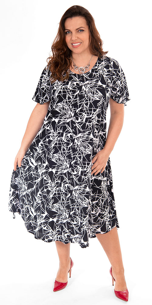 This image shows a model wearing a gorgeous dress from Angel Circle. Available in plus sizes.