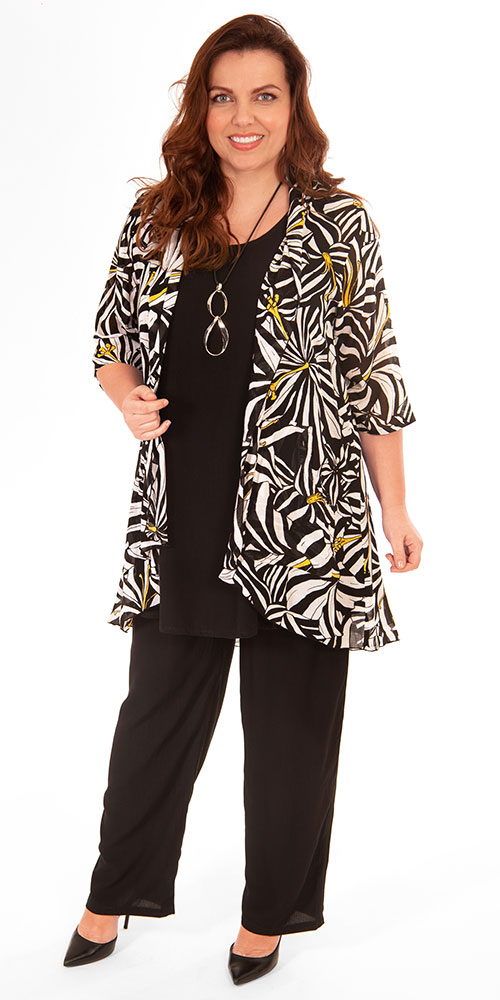 This image shows a model wearing a stunning patterened kimono jacket by Angel Circle teamed with Angel Circle long black vest and trousers. Available in plus sizes from Bakou.
